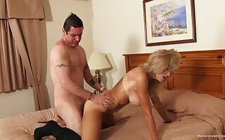 Auntie likes the warm feel of cock in her ass