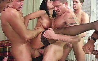 Wild Patricia D. gives up all holes to a throng of horny males