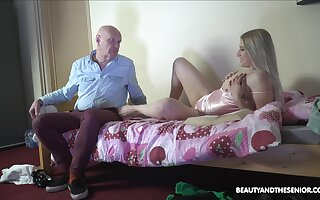 Aroused blonde welcomes older man for a few rounds of sex