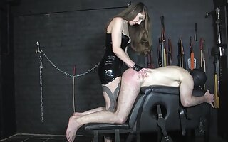 Domineering Miss Alex slaps her sissy sub's ass with all of her might