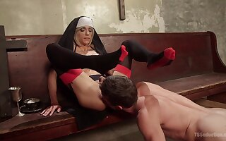 Nina Lawless assumes the role of a slutty nun and works with a jailed man