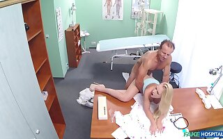 Busty young blonde tries her doctor for a few sex rounds