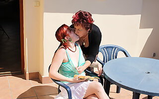 mature lesbian doing a hot babe on the roof