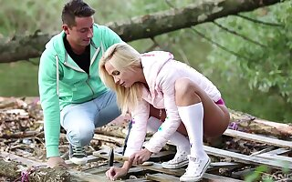 Blonde amateur taped undeviatingly exhausting a new Hawkshaw in sexy outdoor scenes
